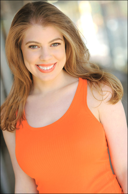Leandra Ramm picture, wearing orange shirt frontal middle close up